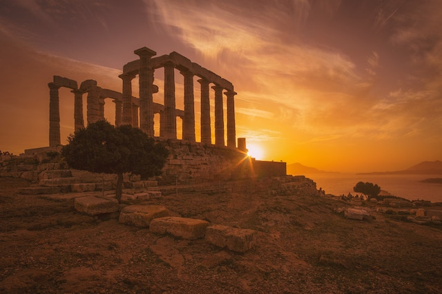 Temple Of Poseidon at Sounion at sunset by Aegean Sea