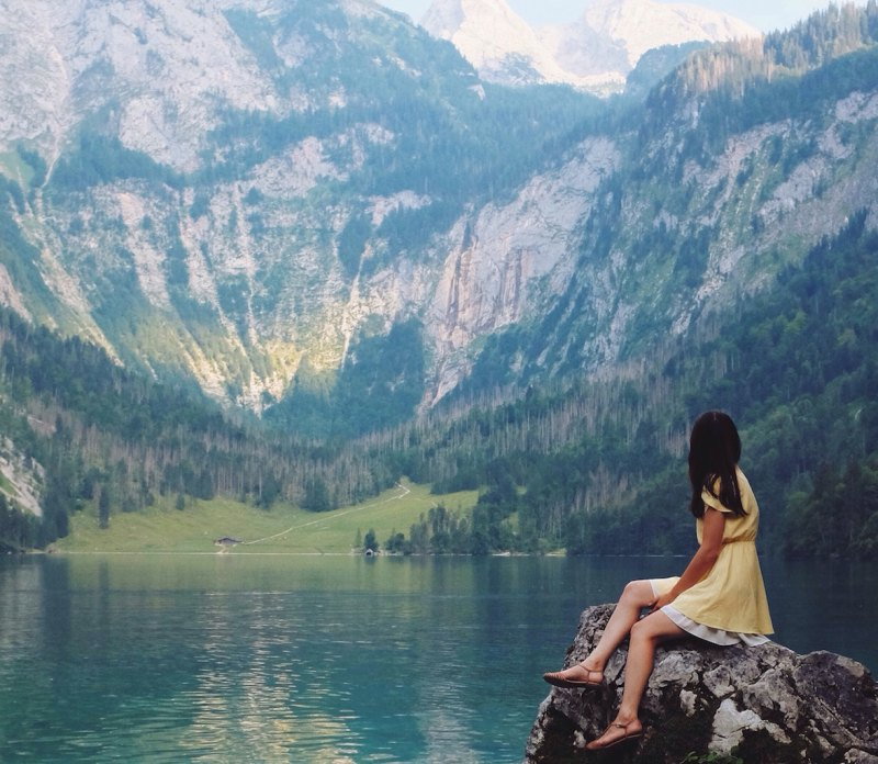 ceremony of meditating in nature with beautiful mountains and lake