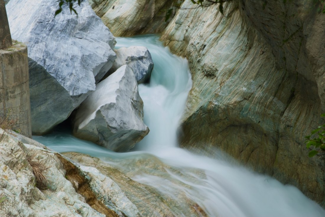 River over rocks, ice blue