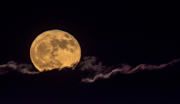 luminous full moon in clouds